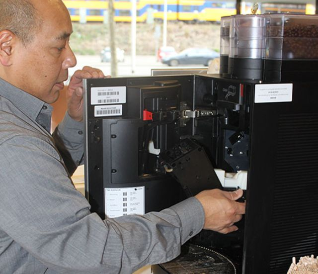 Coffee machine being maintained